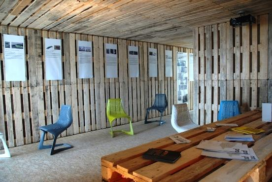cubic pallethouse inside Seven Buildings Made of Recycled Crates