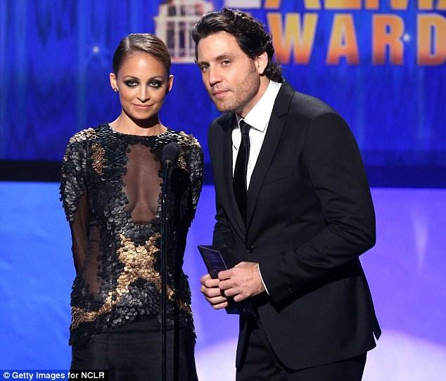 Equally daring: Nicole Richie wore a daring sheer black sequinned gown as she presented alongside Edgar Ramirez