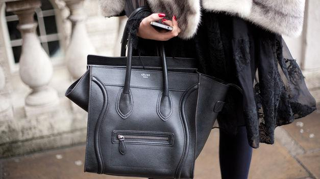 BLACK BAG: Céline luggage.