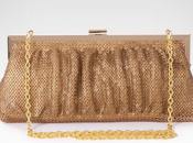 """Clutch"" viste Oro."
