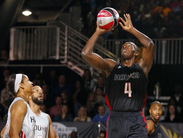 Bolt shoots during the NBA All-Star celebrity basketball game in Houston