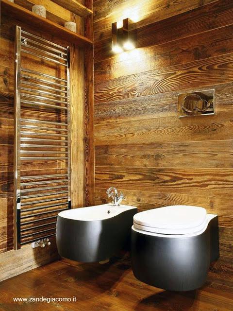 Baños Residenciales Modernos:Moderno baño con la calidez de la madera y contrastes