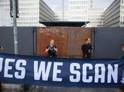 let-s-build-a-home: SCAN Demonstrators hold banner...