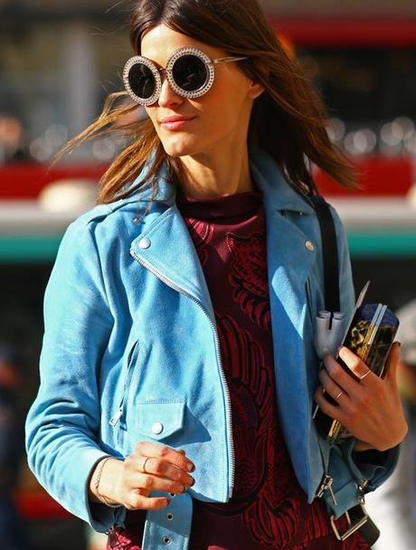 STREET STYLE FASHION WEEK ROUND SUNGLASSES HANNELI MUSTAPARTA BLOGGER EMBELLISHED OVERSIZED SUNGLASSES BLUE SUEDE LEATHER MOTO JACKET EMBROIDERED SWEATER RINGS KNUCKLE RING CLUTCH BAG VOGUE MAGAZINE