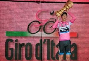 Canada's Ryder Hesjedal holds the trophy after winning the 95th Giro d'Italia, Tour of Italy cycling race, in Milan, Italy, Sunday, May 27, 2012. Hesjedal won the 95th Giro d'Italia finishing 16 seconds ahead of Joaquin Rodriguez in the general classification after overhauling the Spaniard's lead on the final stage in Milan. Hesjedal started the 21st stage 31 seconds behind Rodriguez, but completed the 28.2-kilometer (17.52-mile) individual time trial in 34 minutes, 15 seconds to finish the race in a total time of 91 hours, 39 minutes and 2 seconds. He becomes the first Canadian to win the Giro. Marco Pinotti won the stage in 33:06. (AP Photo/Gian Mattia D'Alberto)