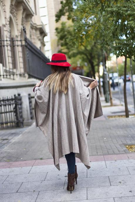 street style barbara crespo merino royale poncho red hat winter is coming outfit