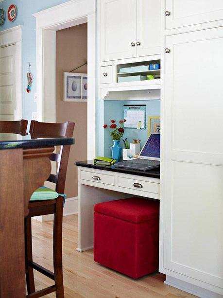 Love the idea of the storage ottoman in place of a regular chair...more storage space for a small built-in desk!