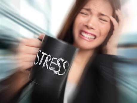 Stress - business person stressed at office. Business woman hold
