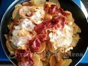 Patatas fritas huevos jamón serrano.