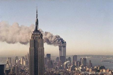FILE - In this Sept. 11, 2001, file photo, the twin towers of the World Trade Center burn behind the Empire State Building in New York. The twin towers stood as New York's tallest from 1972 until the terrorist attacks of Sept. 11, 2001, when two planes crashed into the World Trade Center causing the twin 110-story towers to collapse, making the Empire State Building the tallest once again. (AP Photo/Marty Lederhandler, File)