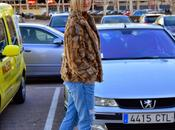 Fluffy coat, animal print ripped jeans. Retro hat.