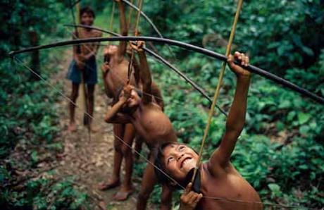 Yanomami boys practising hunting, Amazon, Brazil