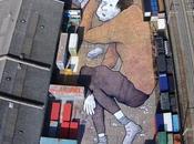 Arte urbano. Enormes dibujos personas durmiendo
