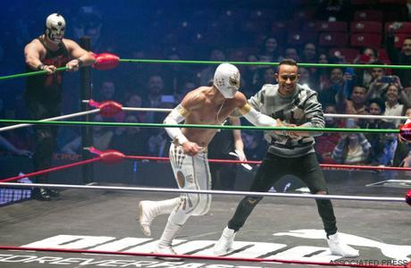 2015 Formula One champion Lewis Hamilton, from Great Britain, pretends to fight with famous Mexican Lucha Libre wrestler   Mistico during a promotional event for Puma in Mexico City, Wednesday, Oct. 28, 2015. Mexico will hold its first Formula One race in 23 years on Sunday at the Hermanos Rodrigues racetrack..(AP Photo/Eduardo Verdugo)