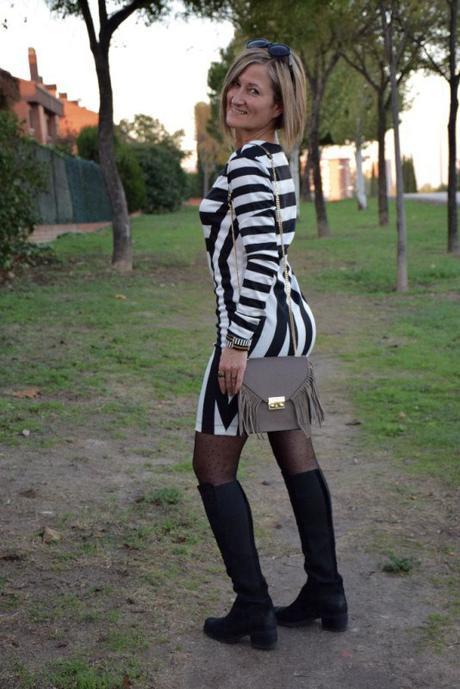Tall boots and striped dress