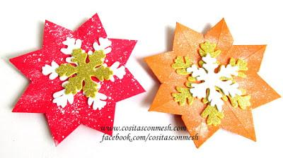 guirnalda navidea con estrellas de papel y copos de nieve