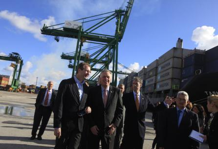 Democratic Governor Terry McAuliffe of Virginia (C) walks near members of his delegation at the Mariel port in Artemisa province, Cuba  January 5, 2015. Virginia's port authority will become the first U.S. port operator to sign a cooperation agreement with its Cuban counterpart, in an effort to increase trade and establish direct service with Cuba, Virginia's governor said on Monday. REUTERS/Enrique de la Osa