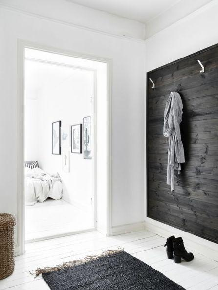 6. Sleek and clean idea: entry with black stained wooden wall
