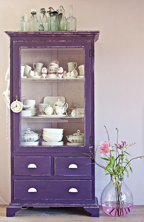 If your apartment doesn't have a pantry- this is a great way to store more dishes. Love the antique and bold color of this one!: