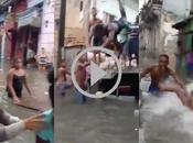 Niños cubanos practican clavado natación calles inundadas Habana