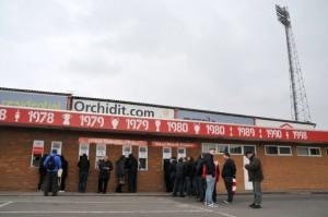 Nottingham Forest fans queue at the ticket collection point at the City Ground before the game