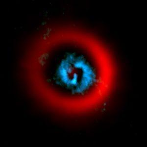 Espirales dentro de un surco en el disco de polvo de una estrella en formación