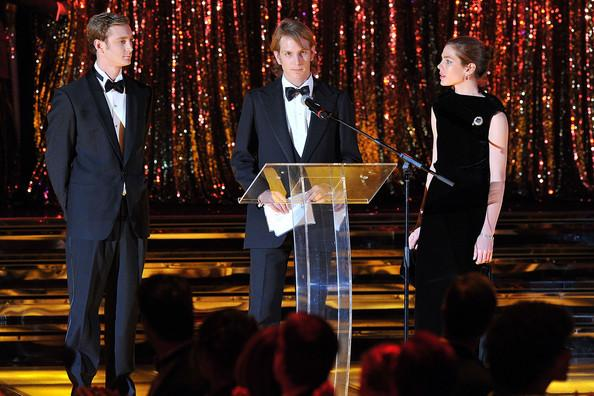 Andrea Casiraghi delivers a speech as Pierre Casiraghi (L) and Charlotte Casiraghi (R) look on during the Monaco Rose Ball 2011 at Sporting Monte Carlo on March 19, 2011 in Monte Carlo, Monaco. This year's Rose Ball will not be attended by the Royal family as they are in mourning after Princess Antoinette of Monaco passed away on Friday at the age of 90.