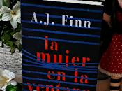 mujer ventana Finn)
