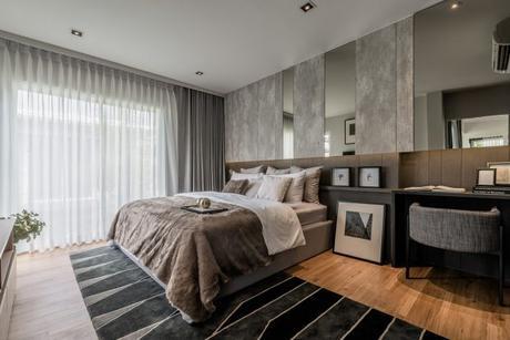 dormitorio con paredes enteladas