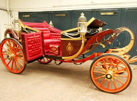 The 1902 State Landau carriage at the Royal Mews in central London which  will carry Britain's Prince William and Kate Middleton on their wedding - AP