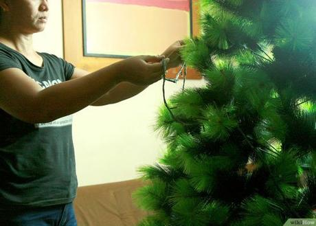 Cómo colocar las luces en el árbol de navidad