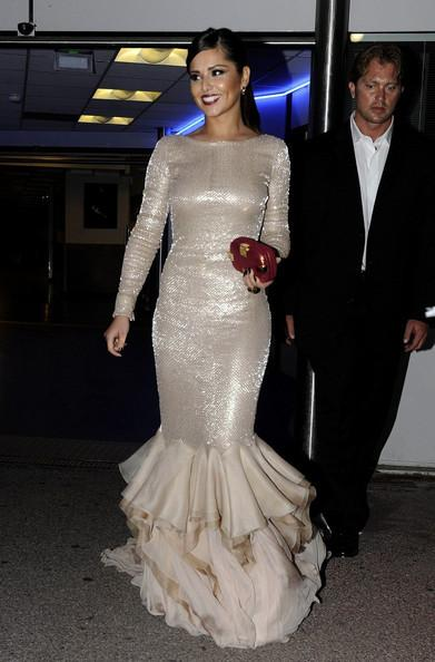 Cheryl Cole steps out of the Palais des Festivals in a skin tight glittery dress.