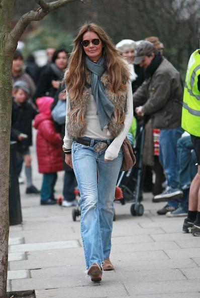 Elle MacPherson Elle Macpherson looks smiley and stylish in her fur body warmer on the school run today.