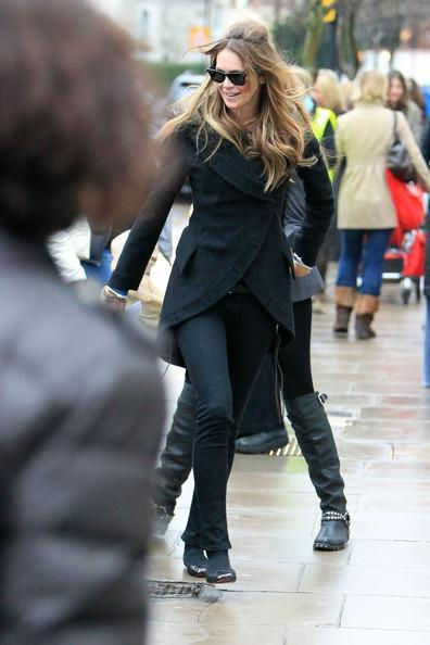 Elle MacPherson Supermodel Elle Macpherson chats to a pal during the school run in London.