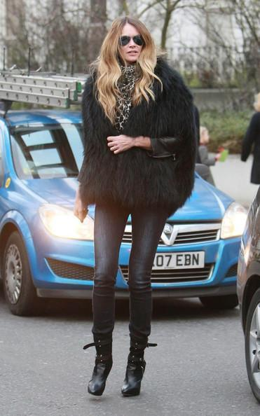 Elle MacPherson Super model Elle MacPherson is seen on the school run in West London. Elle opted to wear this seasons must have; a warming faux fur gilet, but when will the costume rental shop get there gorilla costume back!.