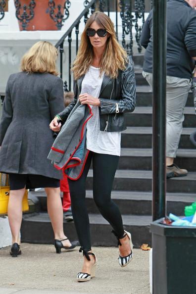 Elle MacPherson Elle Macpherson looks stylish in a black leather jacket on the school run.