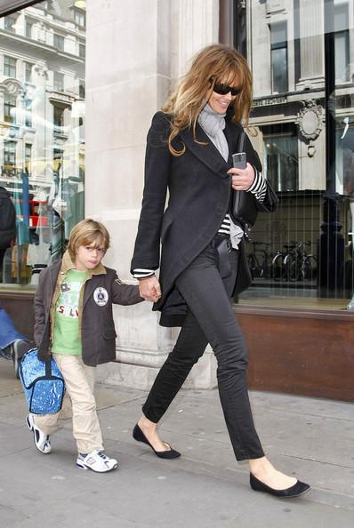 Elle MacPherson Model Elle MacPherson takes her two boys, Flynn and Aurelius Cy, to visit the Apple Computer Store on Regent Street in London. She has been unveiled as the new brand ambassador for cosmetics giant Revlon Inc.