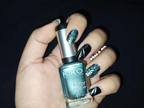 Diseño de uñas en negro y verde metalizado