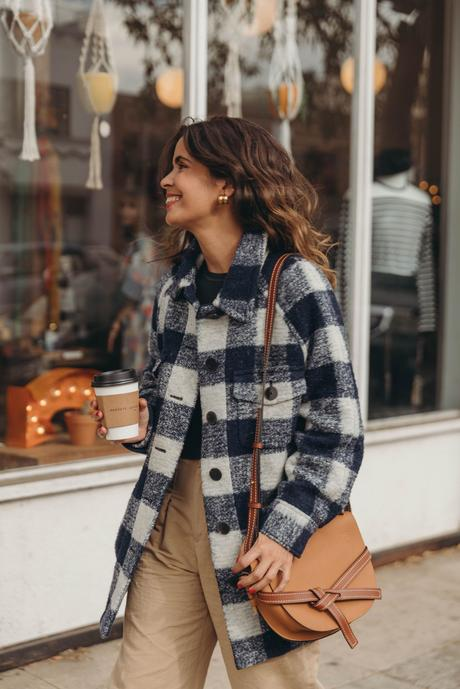 Collage Vintage wearing a plaid overshirt from Sézane