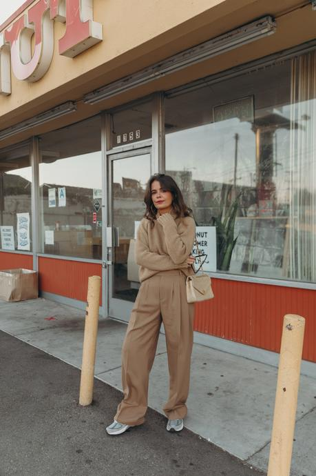 Sara from Collage Vintage wearing a camel pullover and pleated high waist trousers from Closed