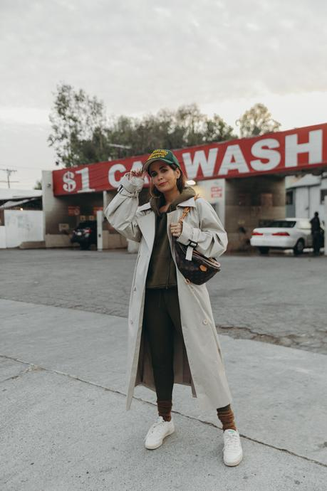 Sara from Collage Vintage wearing a Nili Lotan set in army green paired with a vintage trench coat and Reebok retro sneakers