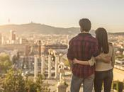 Young couple looking sunset Barcelona, they embracing cityscape from Montjuic.