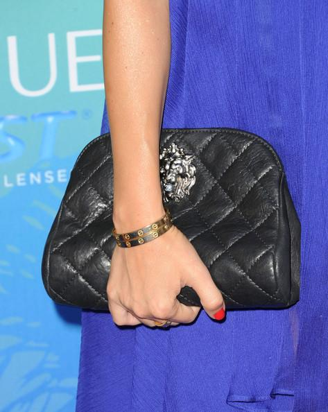 TV personality Kourtney Kardashian (purse detail) arrives at the 2011 Teen Choice Awards held at the Gibson Amphitheatre on August 7, 2011 in Universal City, California.