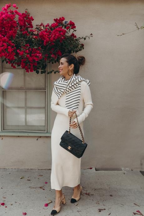 Sara from Collage Vintage wearing a champagne long knit dress and Chanel slingback sandals