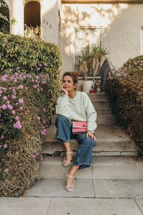 Sara from Collage Vintage wearing H&M sweatshirt, Zara cropped wide-leg jeans and Chanel vintage bag