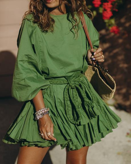 Sara from Collage Vintage wearing a Rhode green summer dress, espadrilles and a Loewe basket bag