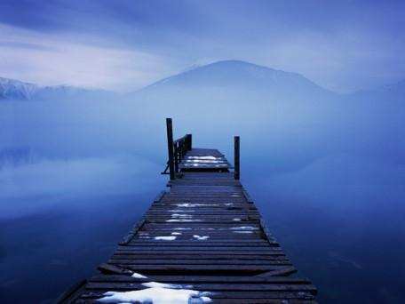 Dilapidated Jetty on Foggy Lake