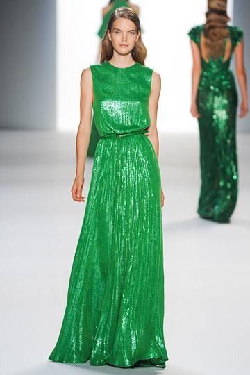 Let's talk Elie Saab Paris Fashion Week Spring 2012 in green. Shall we?This shiny green dress walked down the runway in Paris a couple weeks ago and honestly I just didn't think I would love anything shiny green like this in fashion. Wrong. This Elie Saab dress is gorgeous. Shiny green the only question is will you be my friend in decor. I really don't know. However, if Miles Redd is involved you just might be. My friend that is.